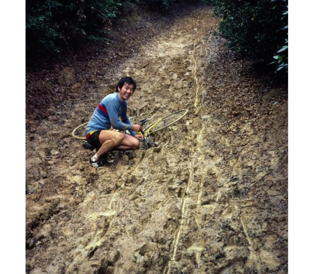 You too can ride in mud. Ted Mock takes a spill on Roberts Road in 1981.