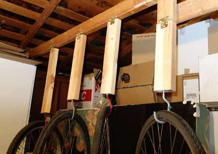 Lowering hooks makes for easy bike storage in the garage.