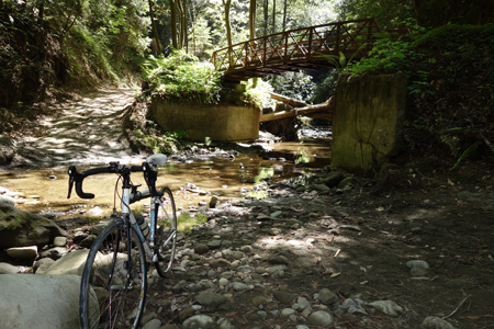 Back in the 1980s we had to ride through the creek. Now there's a nice bridge.
