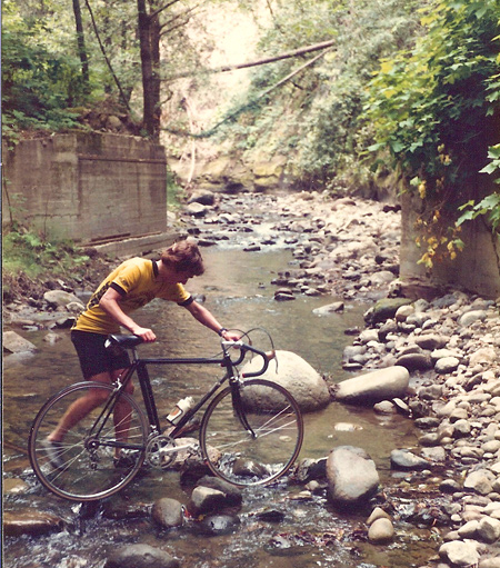 Ray Hosler walks his bike through Aptos Creek on June 21, 1982. (Jobst Brandt photo)