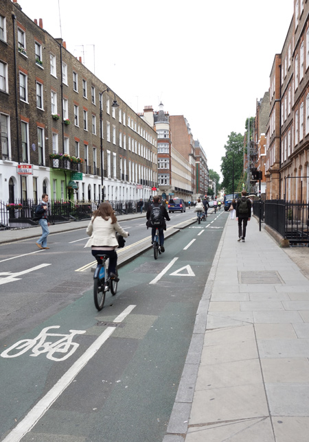 Tavistock Place bike lane in Camden London. Dense residential area north of London.