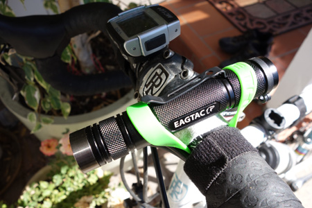 Cause bracelets work well for mounting a flashlight on handlebars.