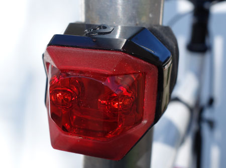 Flashing lights are OK to use on bikes.