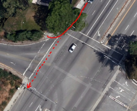 Don't go punching pedestrian lights while on a bike, unless you're walking or it's designated for bikes. (Google maps photo)