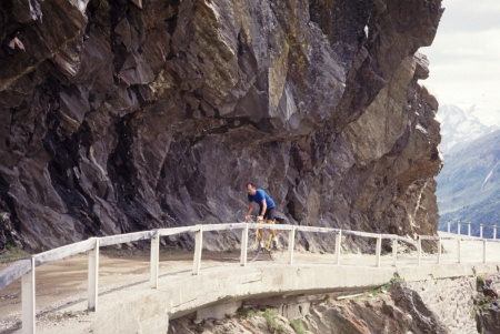 Jobst Brandt on Gavia Pass, in the late 1980s. A tunnel was built about 1991 and this part of the road abandoned. This perspective does not compare to the one made into a poster, but still nice.