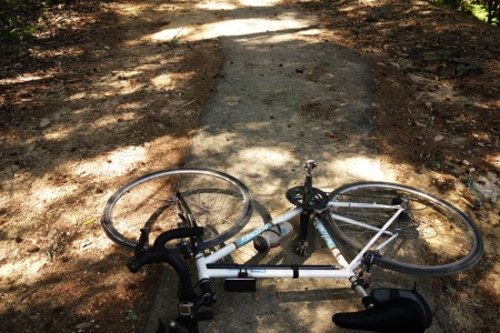 Pavement on upper Gazos Creek Road. Still a rough ride on a road bike.
