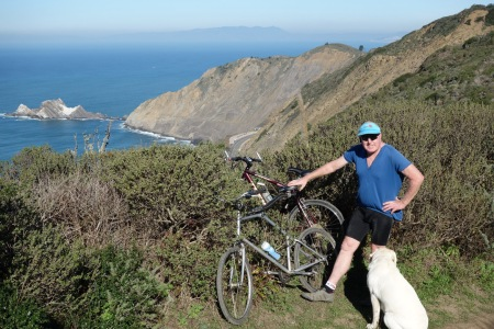 Jim Sullivan shows the way as we stop to admire San Pedro Point and Hwy 1. Faithful Tanga looks on.
