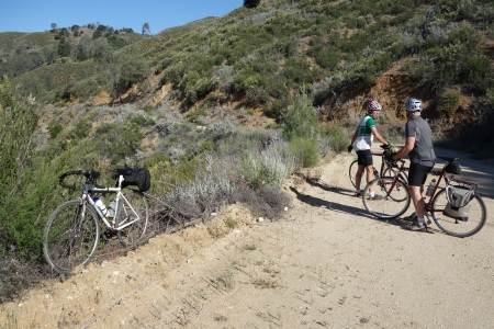 John Woodfill and Ned Black discuss next steps on Milpitas Road before the descent.