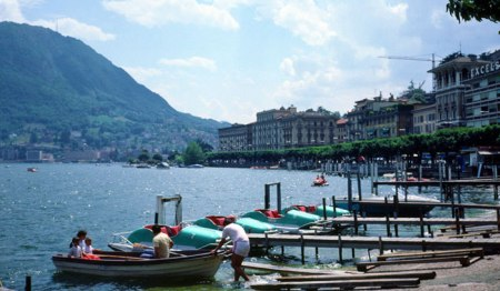 Lake Lugano with palm trees.