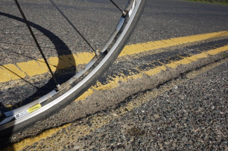 Be aware of this nasty rut at Shotgun Bend, Page Mill Road.