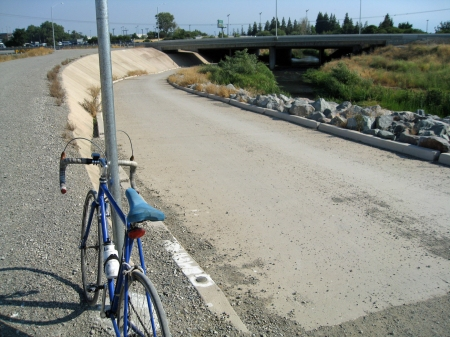 Crossing under Hwy 101 on the scenic Guadalupe River trail avoids traffic.